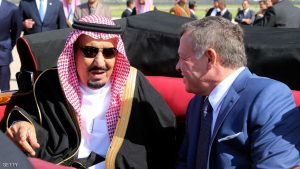 AMMAN, JORDAN - MARCH 27: In this Handout photo released by the Jordanian Royal Court,  King Abdullah II of Jordan (R) welcomes King Salman bin Abdulaziz Al Saud of Saudi Arabia (L) upon his arrival at Marka military airport on March 27, 2017, in Amman, Jordan.  King Salman arrived in Jordan to attend the summit of Arab leaders scheduled on March 29, 2017. (Photo by Jordanian Royal Court via Getty Images)