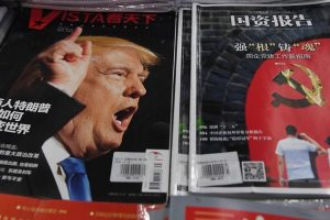 """A magazine featuring US President-elect Donald Trump is seen at a bookstore in Beijing on December 12, 2016.   The headline reads """"How will businessman Trump change the world"""". Beijing is """"seriously concerned"""" by US president-elect Donald Trump's suggestion that he could drop Washington's One China policy unless the mainland makes concessions on trade and other issues, it said on December 12. / AFP / GREG BAKER        (Photo credit should read GREG BAKER/AFP/Getty Images)"""
