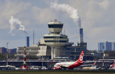 An Air Berlin passenger aircraft taxis in front of the control tower and main terminal of Berlin's Tegel (Otto Lilienthal) airport April 20, 2017. Tegel was expected to close down in 2012 after the opening of Berlin's new Willy Brandt Berlin Brandenburg International airport (BBI) which has yet to be completed. / AFP PHOTO / John MACDOUGALL        (Photo credit should read JOHN MACDOUGALL/AFP/Getty Images)