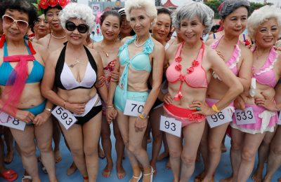 Participants in the Third Grandbikini event wear their bikinis as they wait for judges decisions in an aqua park in Tianjin, China July 22, 2017. Over 400 participants, all older than 55, walked before judges in bikinis, traditional and evening dresses in an annual event organised by local elderly welfare group. REUTERS/Damir Sagolj